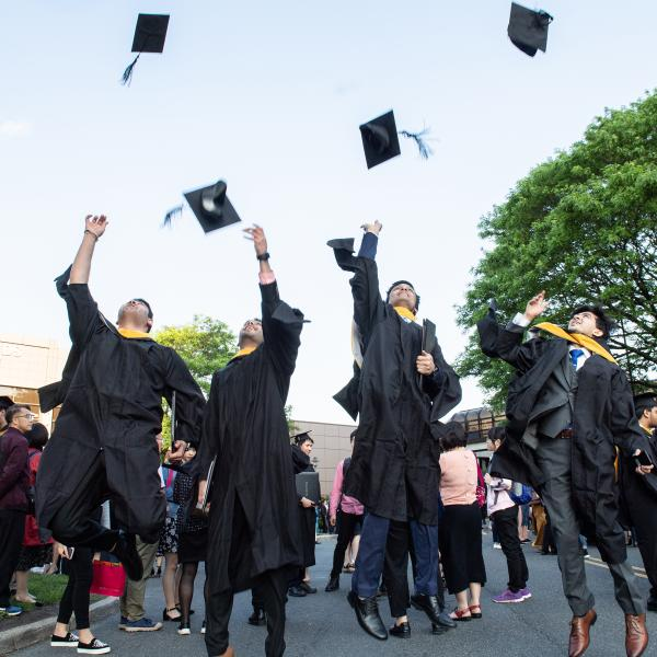 Students tossing caps to celebrate graduation