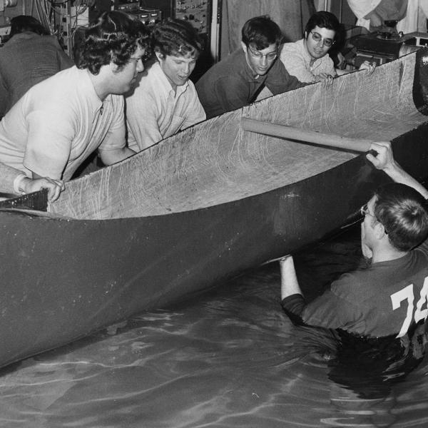 Students maneuver a canoe in Davidson Lab