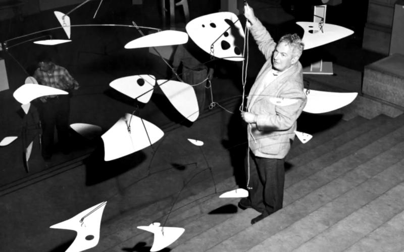 Alexander Calder with a mobile art installation