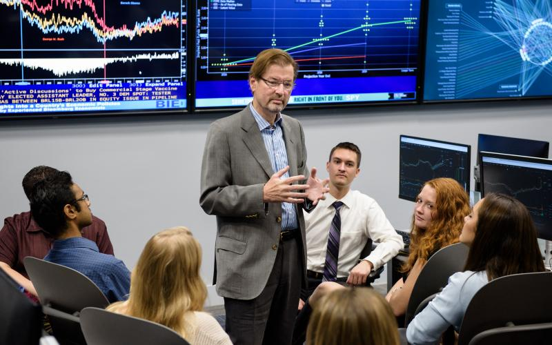 Dr. George Calhoun with students in a Stevens financial laboratory