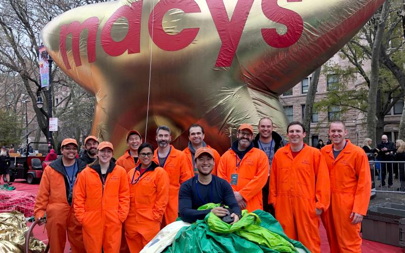 Stevens volunteers stand in front of Macy's balloon
