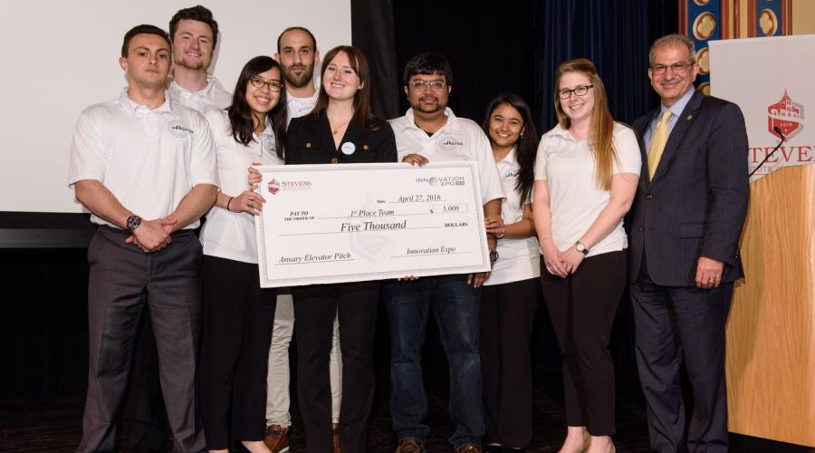 Student winners of Ansary Entrepreneurship Competition pose with giant check and President Nariman Farvardin