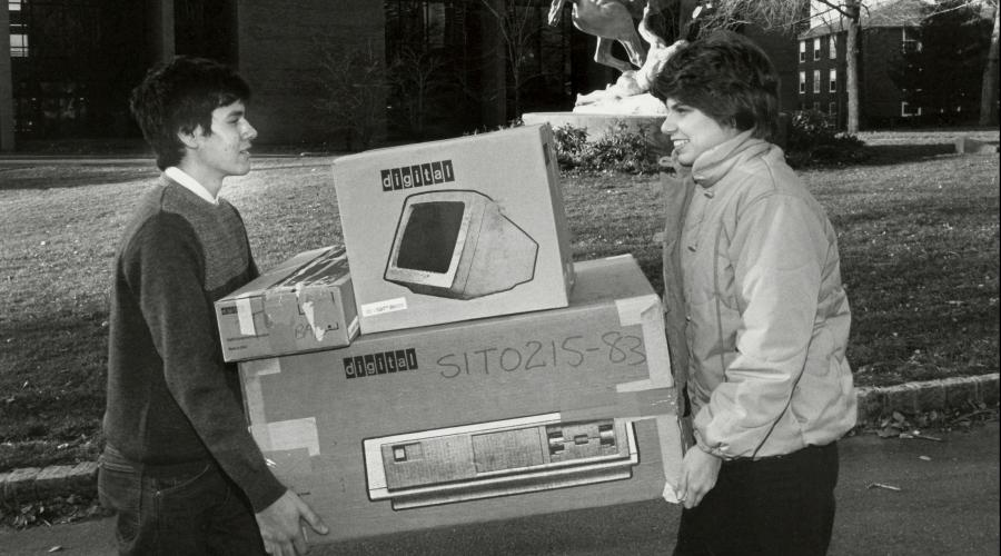 Students carry computer across campus
